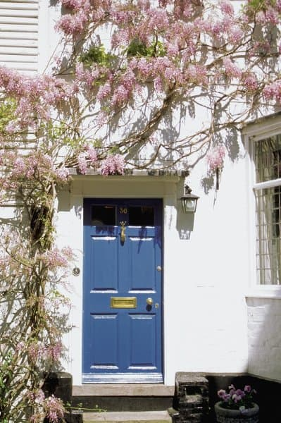 Paint your front door in a vibrant colour and add personality to your home.