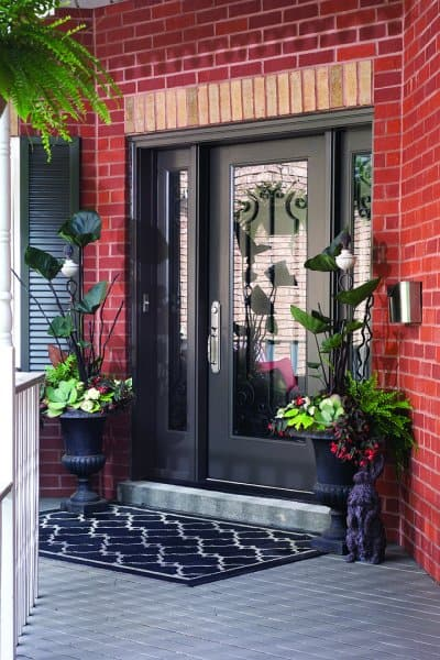 Place decorative pots or urns with seasonal plantings up the steps to the door or on either side of the front door to add colour and texture.