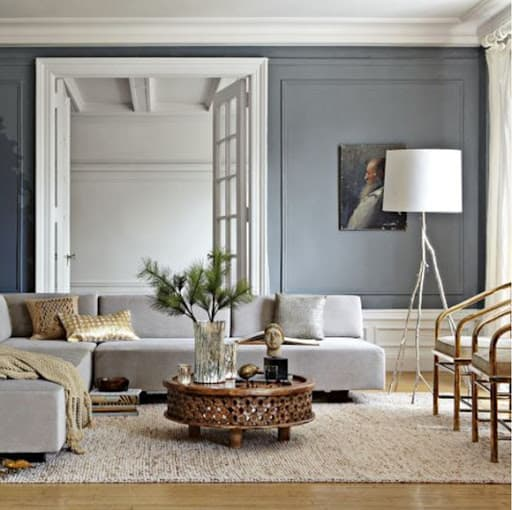 living room with crown moulding
