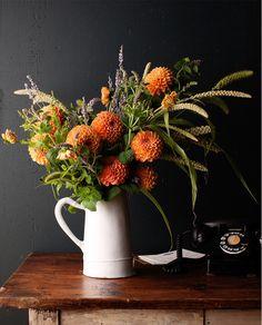flowers in white jug