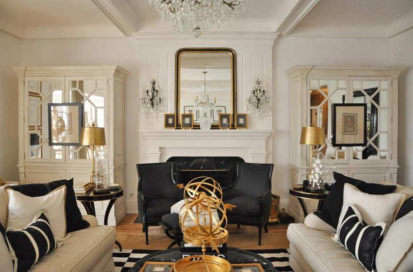 living room interior design with fireplace. Beautiful Interior Whitelivingroomgoldaccentsblackdetailsfireplacemanteldecor  Home  Trends Magazine Throughout Living Room Interior Design With Fireplace