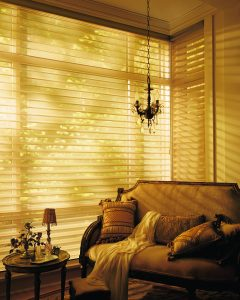 Hunter Douglas sets the gold standard with technical innovation and dynamic use of colour and fabric. Shown above, Alustra Silhouette window shadings in Gold Radiance fabric and hardware.