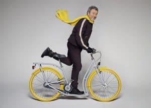 philippe-starck-on-yellow-bike