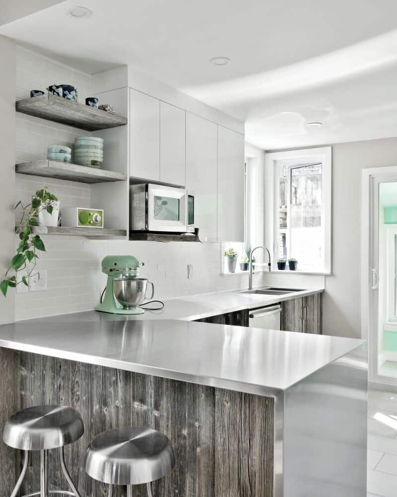 Q: I love the unique look of stainless steel counter tops but I'm wondering  how they stand up compared to other more traditional materials?