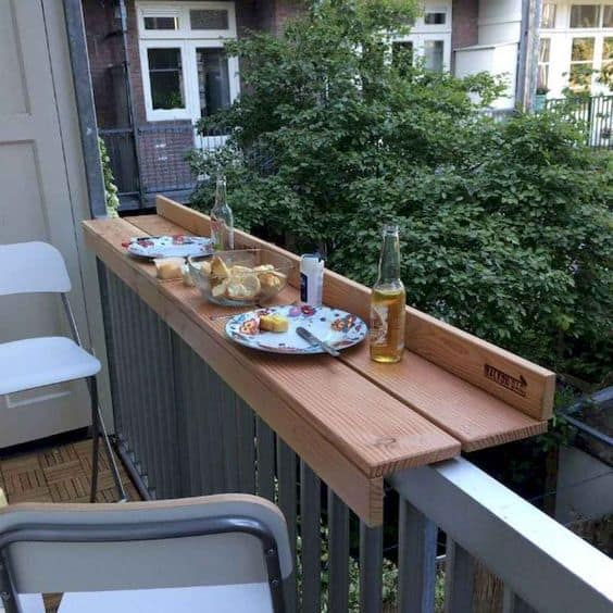 table on the ledge on a small balcony