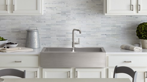 A stainless steel apron front sink brings country and city together in this design.